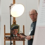 Behind the lens: watch Greg Denton paint the final canvas in a 100-portrait project