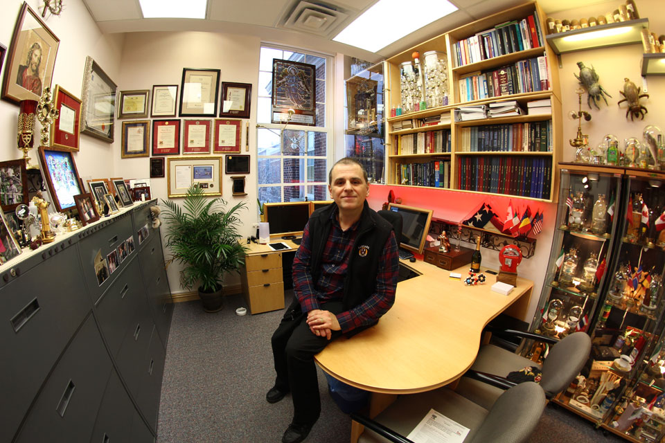 Massimo Marcone in his office filled with collectables at the University of Guelph