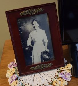 An old photograph resting on handmade doily