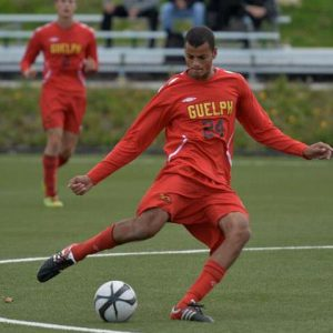Soccer player Justin Springer in red uniform of the Guelph Gryphons